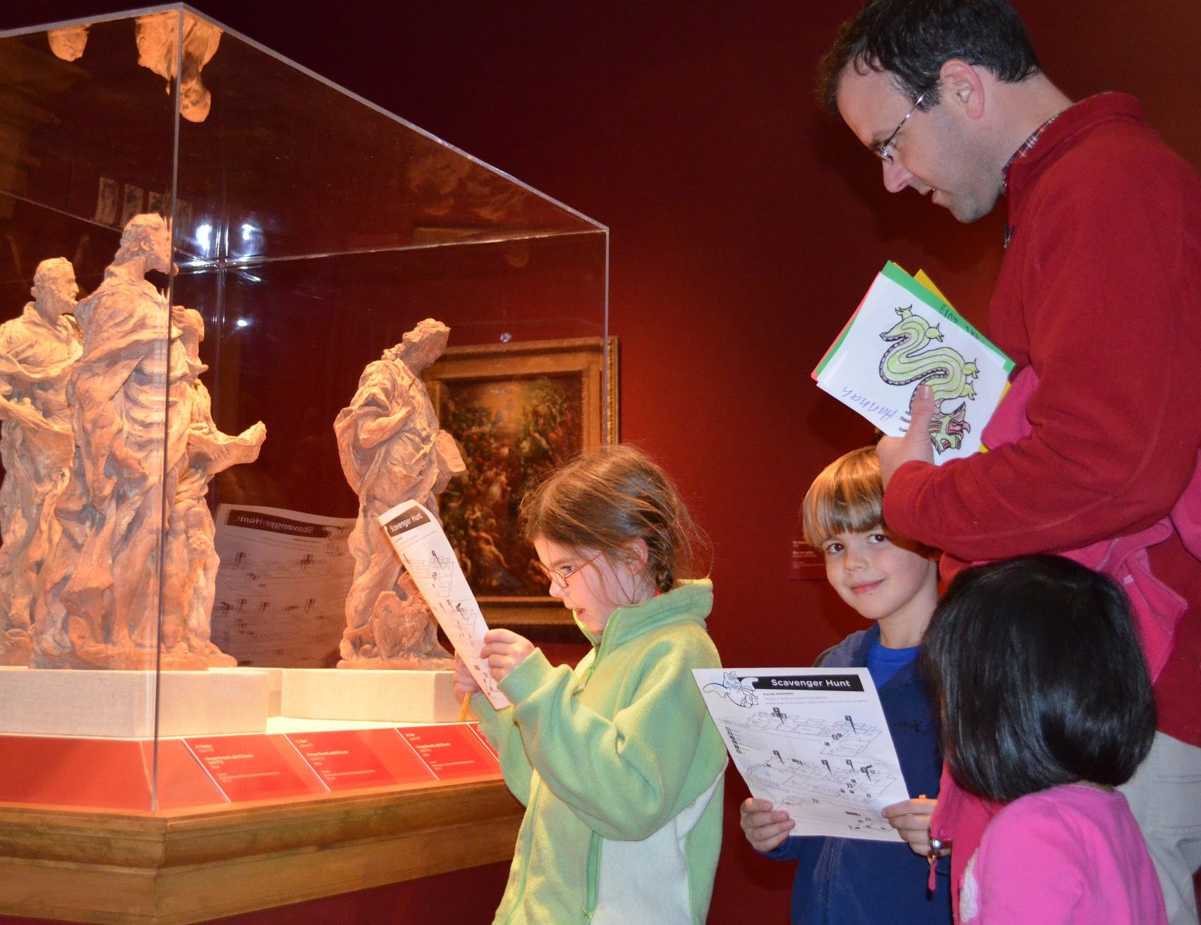 Family viewing sculptures in the gallery.