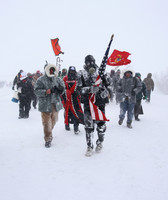 Image of protesters marching in sub-freezing temperatures at the Oceti Sakowin Camp, Standing Rock Sioux Reservation, North Dakota, December 5th, 2016